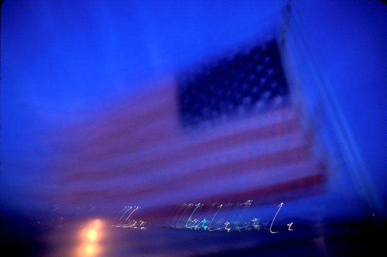 Fading US Flag flying at Guantanamo : US Naval Facility and Prison : Cuba